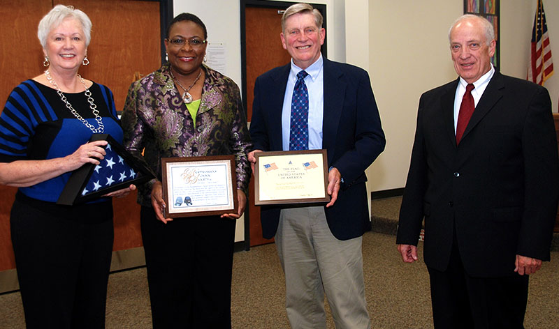 Shown here (l to r) are Linda Monner, RCS Conductor; Mrs. Bass-Fortune, Principal of Chancellor High School; Chuck Parry, RCS President; and Vic Szabo, RCS Facilities Coordinator. The RCS was given an American flag flown over the United States Capitol Building in honor of the Civil War Battle of Chancelorsville (held by Linda Monner) and an accompanying certificate of authenticity signed by the Architect of the Capitol (held by Chuck Parry) for their commemorative Spring 2013 performance of music from the Civil War era. The RCS formally presented the flag and certificate of authenticity, along with a special certificate of appreciation to Chancellor High School (held by Mrs. Bass-Fortune), to Mrs. Bass-Fortune at a meeting of the Spotsylvania School Board. The school proudly displays the flag and certificates at Chancellor High School.